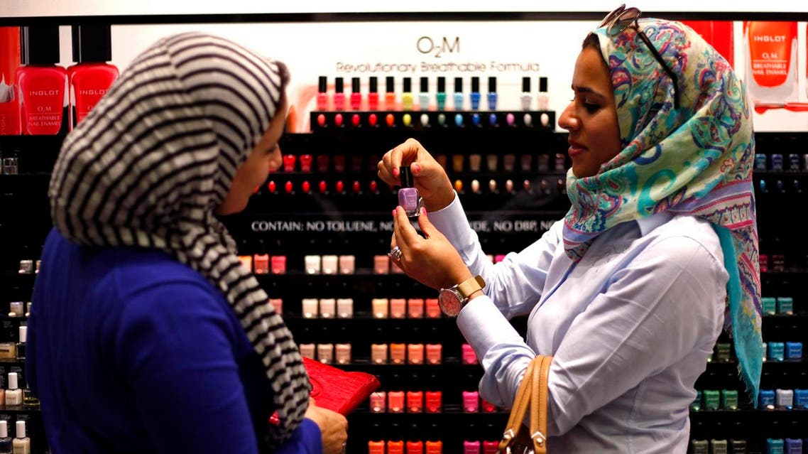 """Two Egyptian women buy """"breathable"""" nail polish from a store in a Dubai shopping mall November 18, 2013. (Reuters)"""