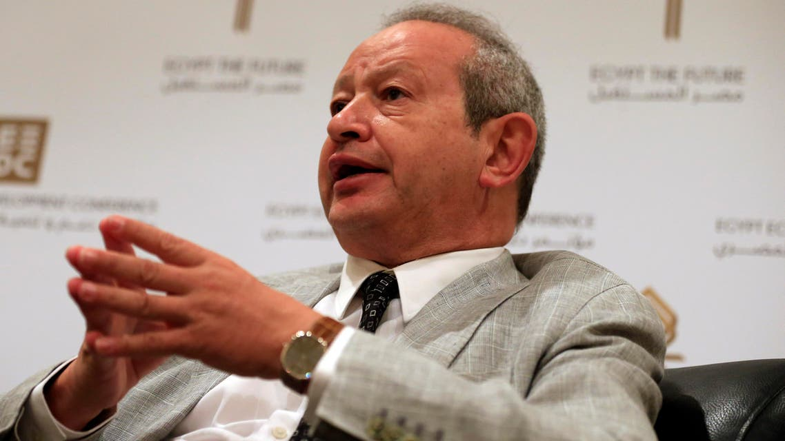 [Window Title] Enter name of file to save to…  [Content] Egyptian billionaire businessman Naguib Sawiris speaks to The Associated Press prior to the opening of a major economic conference seeking billions of dollars in investment, in Sharm el-Sheikh, Egypt, Friday, March 13, 2015.  (AP) The file name is not valid.  [OK]