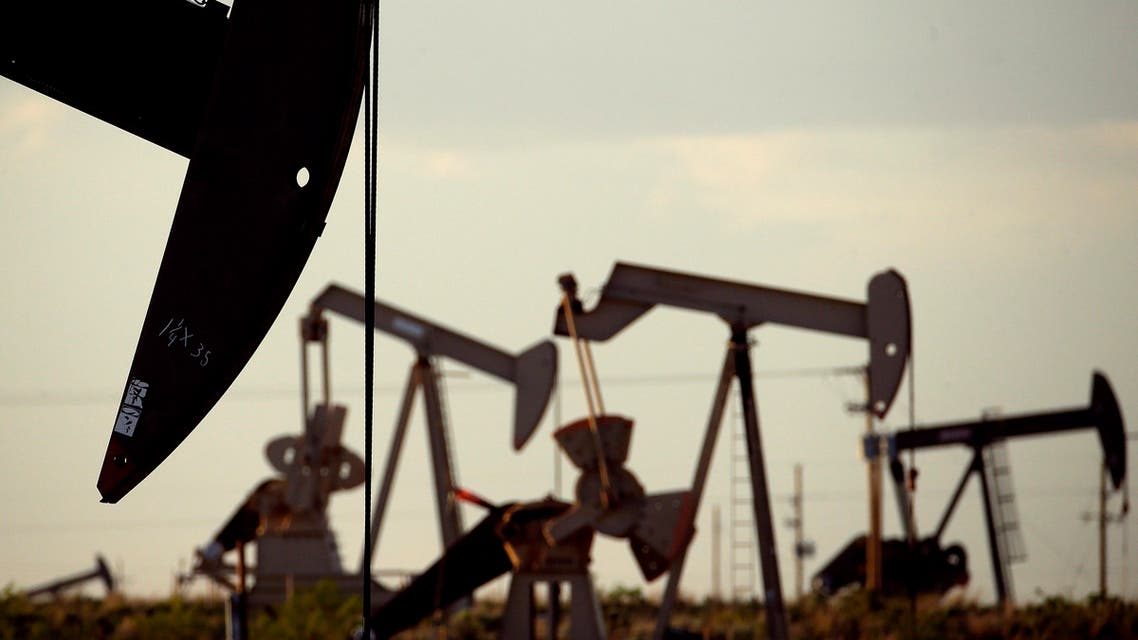 In this April 24, 2015 photo, pumpjacks work in a field near Lovington, N.M. Oil supply from the United States, Russia and other countries outside of OPEC is expected to drop sharply next year. (AP)