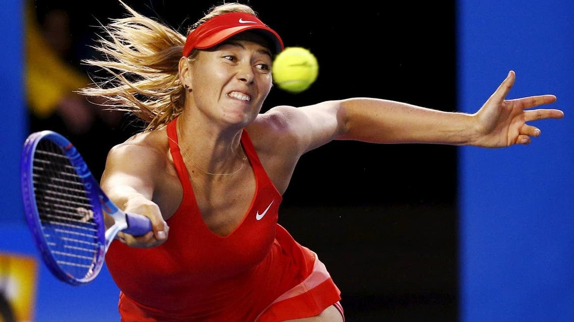 File photo shows Sharapova of Russia stretching to hit a return to Williams of the U.S. during their women's singles final match at the Australian Open 2015 tennis tournament in Melbourne. (Reuters)