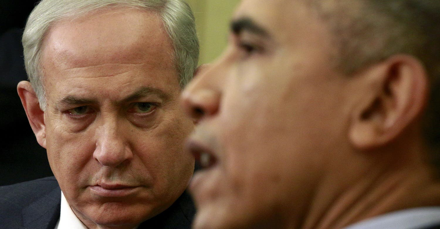 Israeli Prime Minister Benjamin Netanyahu listens as U.S. President Barack Obama speaks during their meeting in the Oval office of the White House in Washington November 9, 2015. (Reuters)