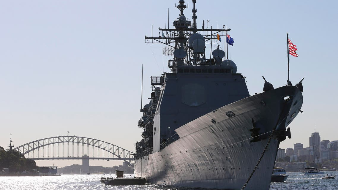 The USS Chosin is seen at anchor in front of the Harbour Bridge in Sydney, Australia, Friday, Oct. 4, 2013 ap