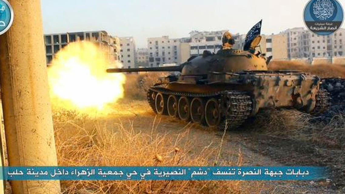 In this image posted on the Twitter page of Syria's al-Qaida-linked Nusra Front on early Tuesday, July 7, 2015, a tank from the Nusra Front fires during their clashes against the Syrian government forces at the western Zahra neighborhood in Aleppo city, Syria. (File photo: AP)