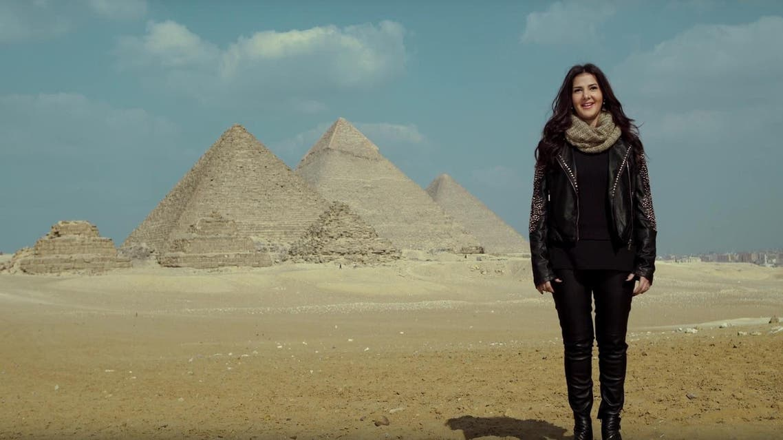 Google's Doodle video featured 25 Egyptian women in front of the camera with the Giza Pyramids in the background, including actress Donia Samir Ghanem. (Google)