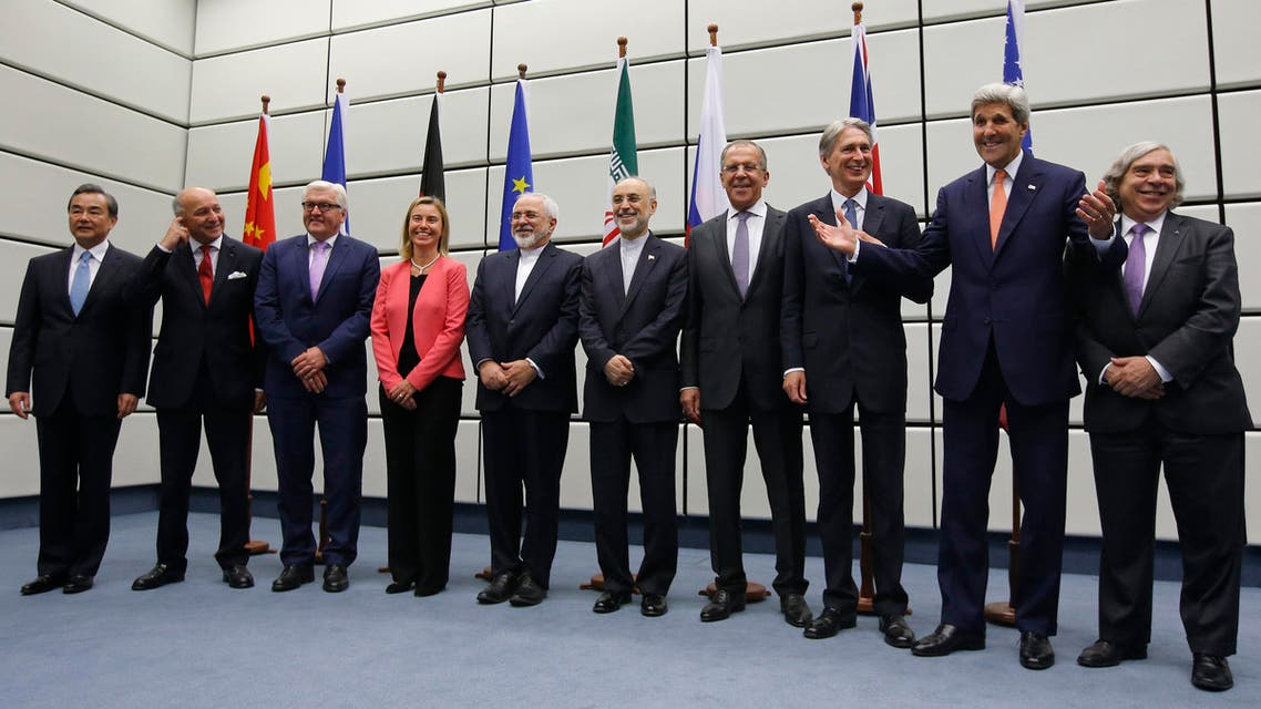 Government ministers from the six world powers and Iran pose for a group picture during negotiations in Vienna, Austria, Tuesday, July 14, 2015. (AP)