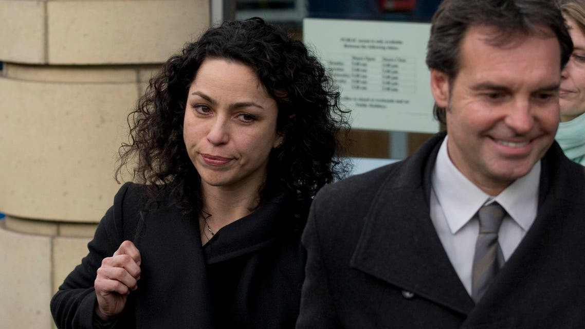 Former Chelsea soccer team doctor Eva Carneiro and her husband Jason De Carteret leave the Croydon Employment Tribunal building after a private hearing where she was claiming constructive dismissal against the English Premier League soccer club, in London Monday March 7, 2016. AP