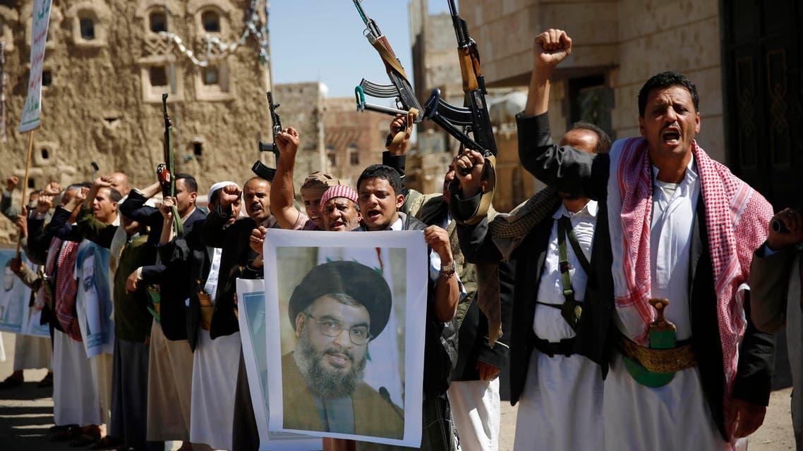 In this Thursday, March 3, 2016 photo, Shiite rebels, known as Houthis, hold a poster of Hezbollah leader Sheikh Hassan Nasrallah during a gathering to show their support to Hezbollah in Sanaa, Yemen. (AP)