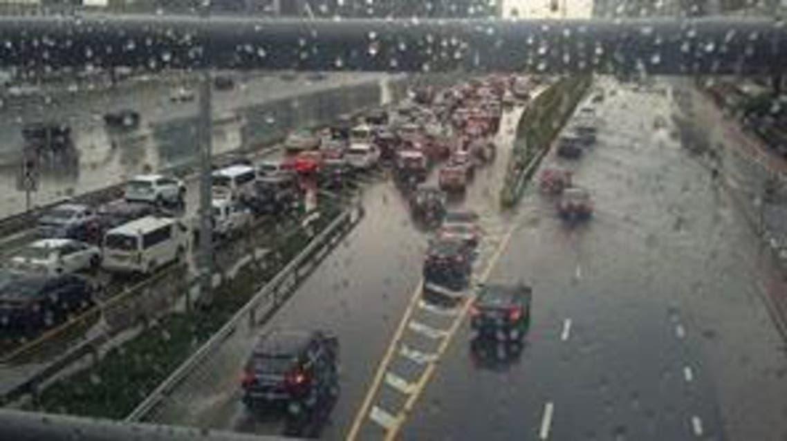 Traffic came to a standstill as heavy showers flooded some roads. (Dina al-Shibeeb/Al Arabiya English)