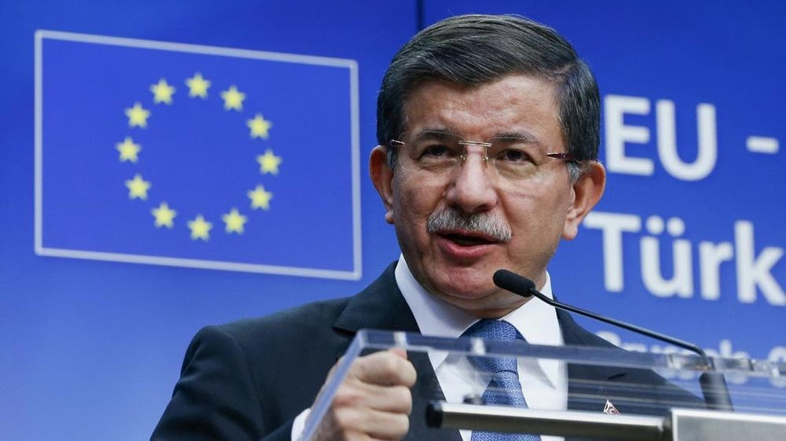 Turkish Prime Minister Ahmet Davutoglu speaks at a news conference at the end of a EU-Turkey summit in Brussels March 8, 2016 (Reuters)