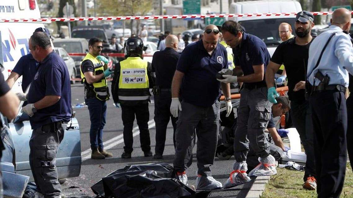 Police stand around the body of a Palestinian involved in a shooting attack in Jerusalem Wednesday, March 9, 2016 (AP)