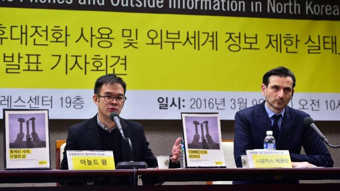 Amnesty East Asia researcher Arnold Fang (L) speaks as Amnesty East Asia regional director Nicholas Bequelin during a press conference on restrictions on mobile phones and outside information in North Korea, in Seoul. (AFP)
