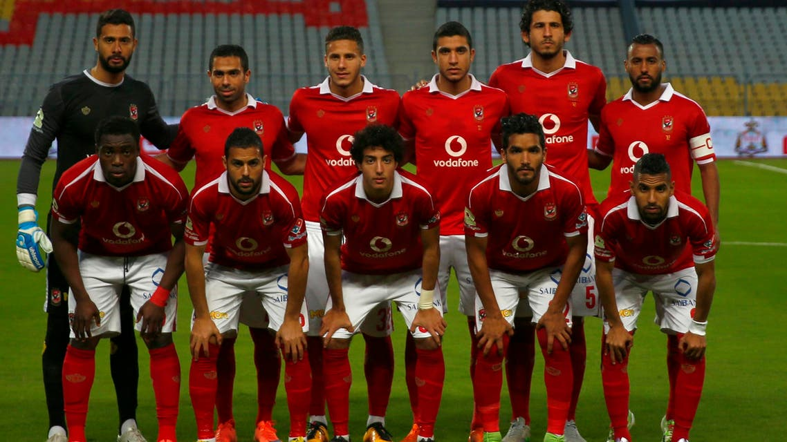 """Al Ahly players pose for pictures before their Egyptian Premier League soccer match against Al Masry at Borg El Arab """"Army Stadium"""", west of the Mediterranean city of Alexandria. (Reuters)"""