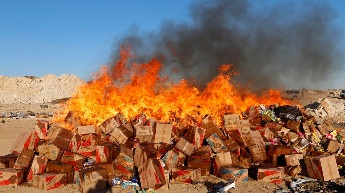 Goods confiscated by men, who say they were hired by the Islamic State to monitor the quality of goods in markets, are set on fire in central Raqqa November 4, 2014. (Reuters)