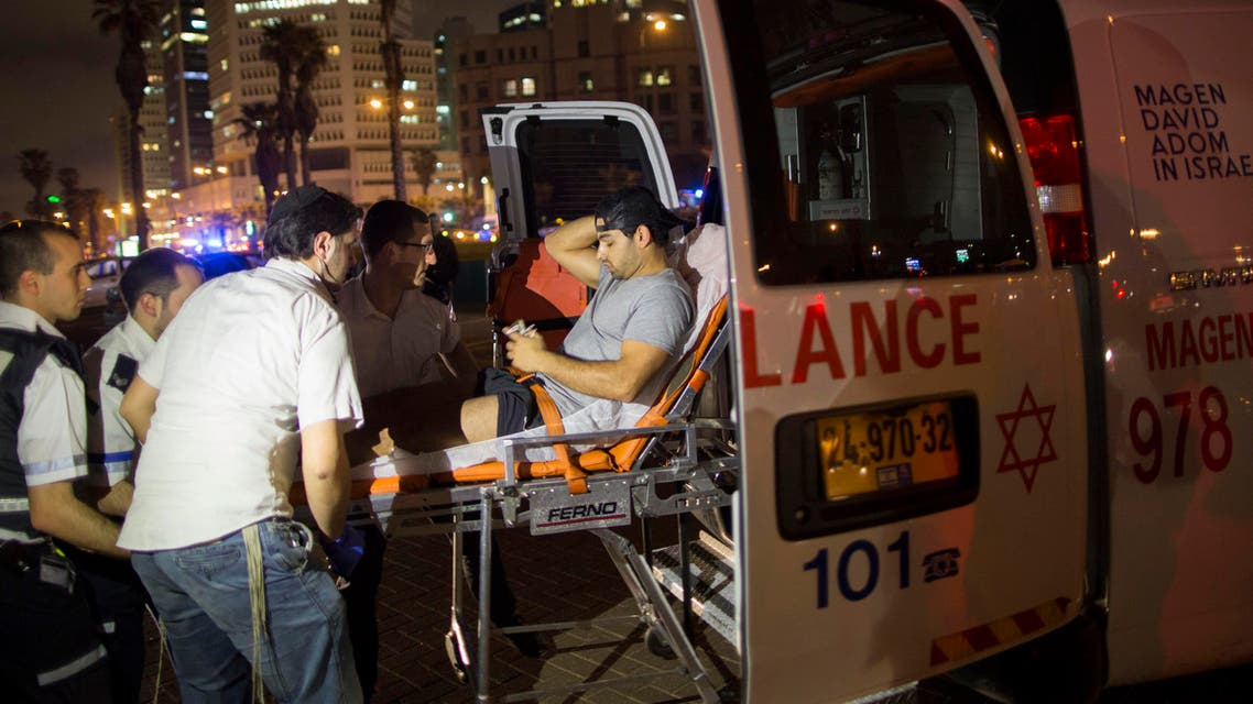 A wounded man is evacuated from the scene of a stabbing attack in Jaffa, a mixed Jewish-Arab part of Tel Aviv, Israel, on Tuesday, March 8, 2016. (AP)