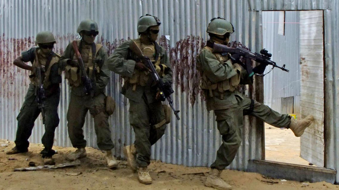 Masked Somali national army (SNA) soldiers search through homes for al-Shabaab fighters, during an operation in Ealsha Biyaha, Somalia, Saturday, June, 2, 2012
