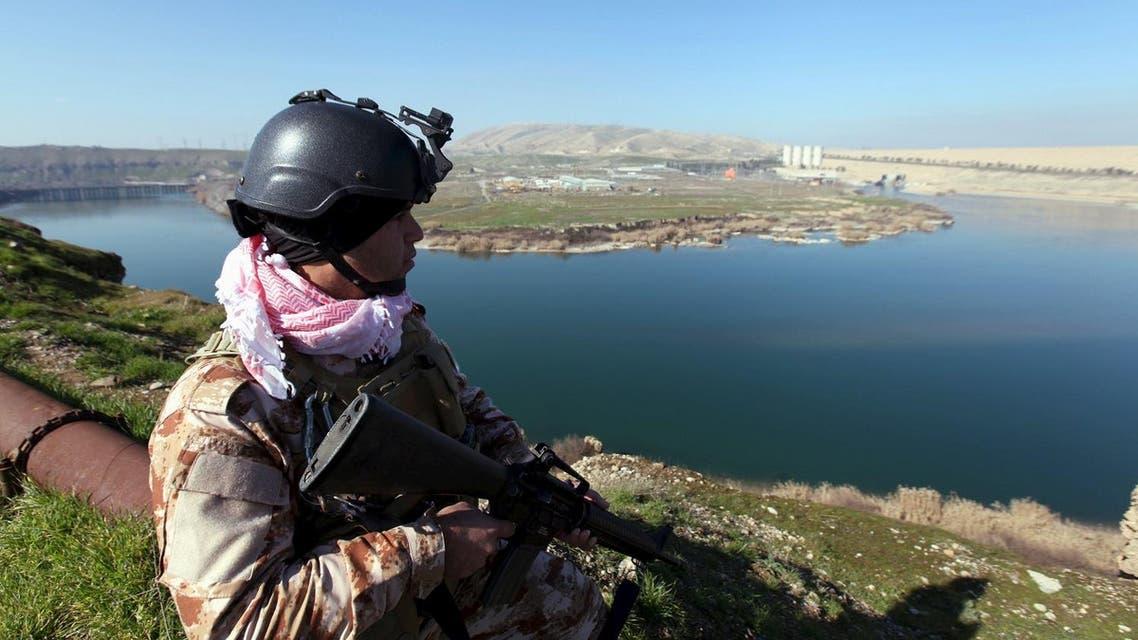 An Iraqi Kurdish Peshmerga stands guard near the Mosul Dam in northern Iraq, February 3, 2016. (Reuters)