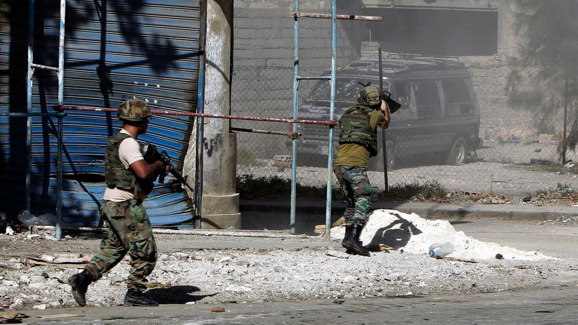Lebanese army soldiers open fire during clashes with Islamic militants in the northern port city of Tripoli, Lebanon, Sunday, Oct. 26, 2014. AP