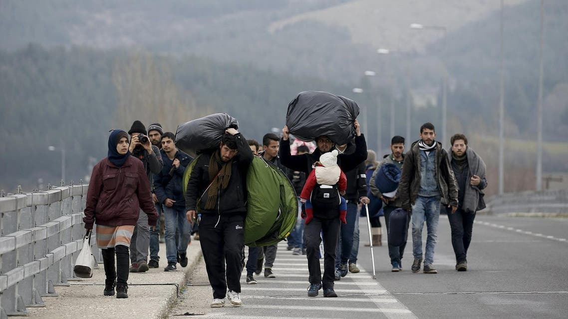 Stranded refugees walk through a motorway towards the Greek-Macedonian border near the Greek village of Idomeni February 26, 2016. At least 20,000 refugees and migrants have been stranded in Greece after border shutdowns through the Balkans route to central and northern Europe. REUTERS