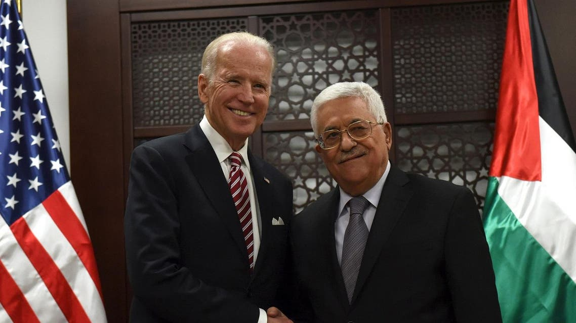 U.S. Vice-President Joe Biden (L) shakes hands with Palestinian President Mahmoud Abbas in the West Bank city of Ramallah March 9, 2016. REUTERS