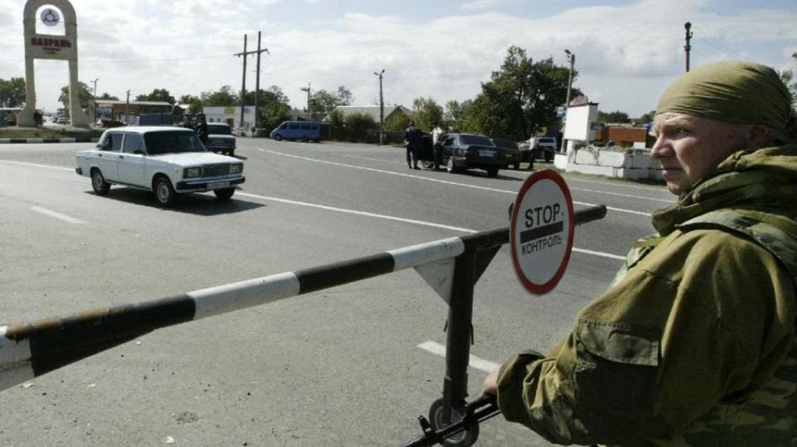A soldier guards a checkpoint in Nazran, in the volatile Russian region of Ingushetia (AFP)