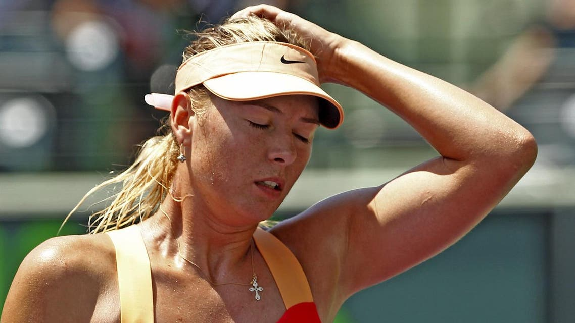 File photo shows Maria Sharapova of Russia reacting during her loss to Agnieszka Radwanska of Poland in the women's final of the Sony Ericsson Open tennis tournament in Key Biscayne. (Reuters)