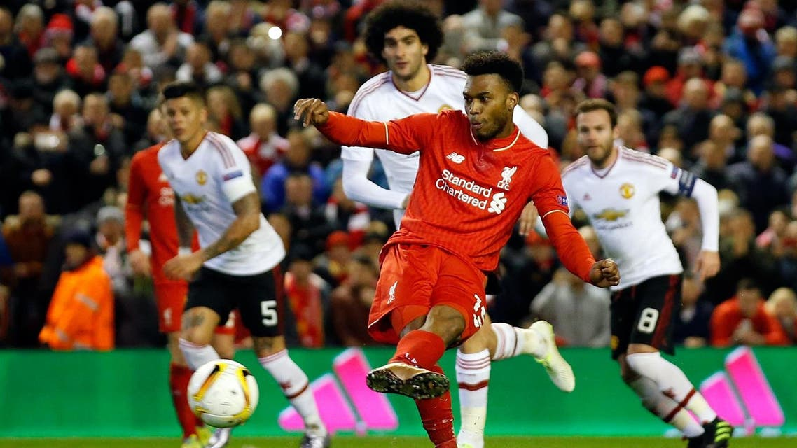 Liverpool's Daniel Sturridge scores the opening goal from the penalty spot during the Europa League round of 16, first leg, soccer match between Liverpool and Manchester United at Anfield Stadium, Liverpool, England, Thursday March 10, 2016. (AP)