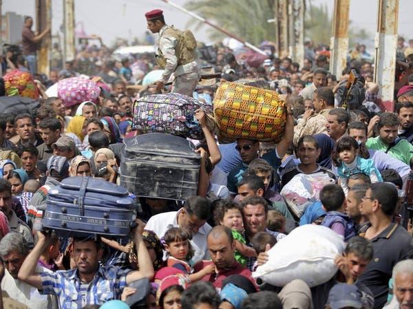 معارك الموصل تجبر مئات المدنيين على الفرار إلى كردستان