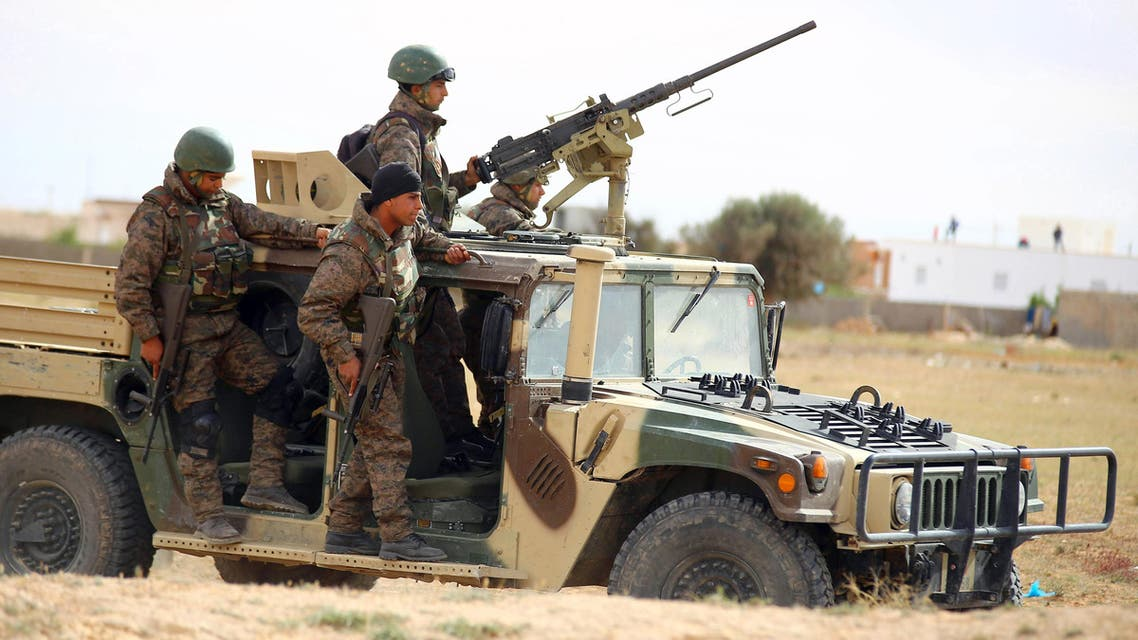 Tunisian soldiers patrol as they search for attackers still at large in the outskirts of Ben Guerdane, southern Tunisia, March 8, 2016. (AP)