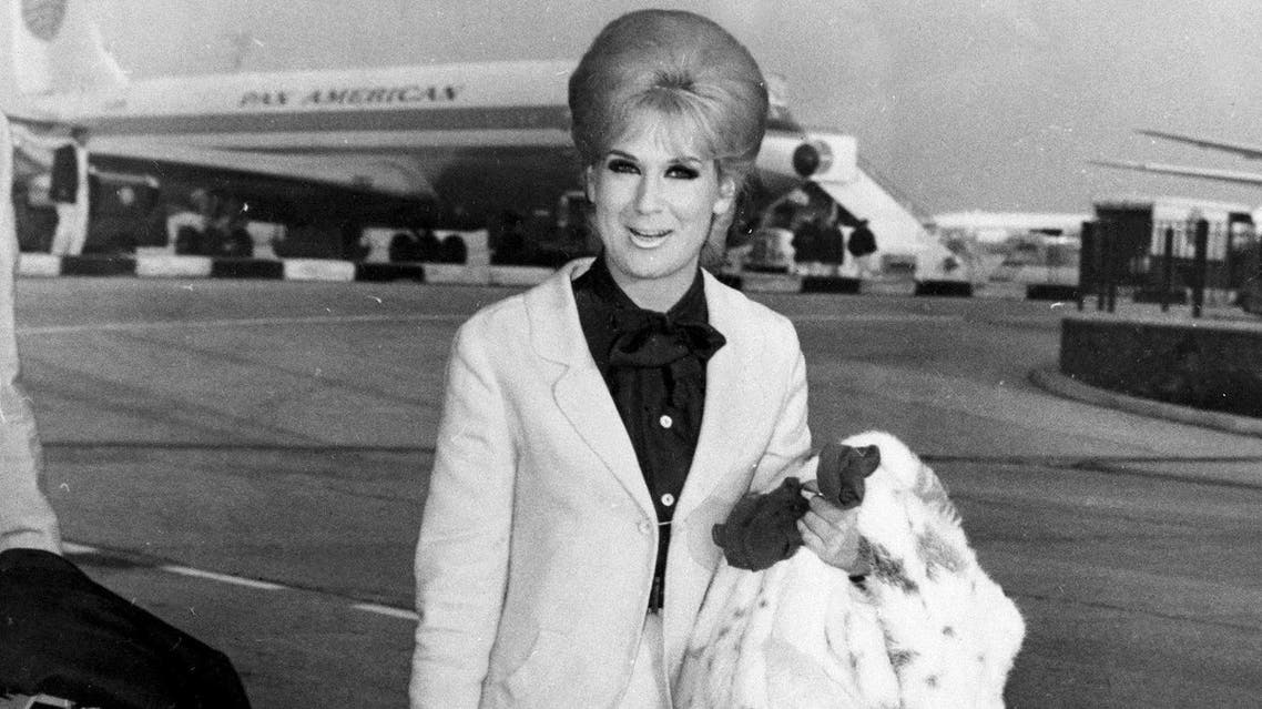 Singer Dusty Springfield arrives in London after being asked to leave South Africa for performing for a multi-racial audience in Capetown, Dec. 18, 1964. (AP)