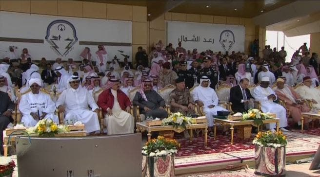 Saudi King Salman and Bahrain King Hamad discuss during the ceremony. (Al Arabiya)