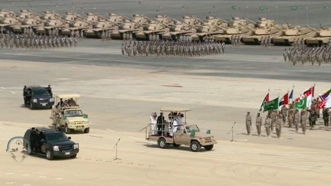 Flags of participating armies march during the ceremony. (Al Arabiya)