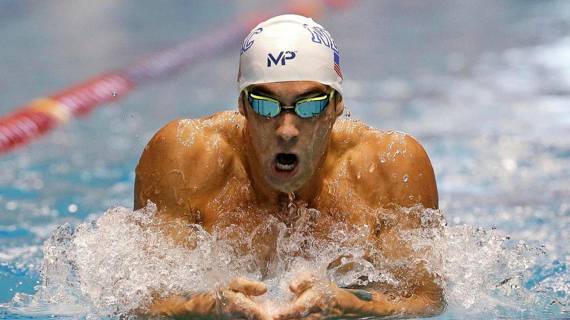 n this Dec. 3, 2015, file photo, Michael Phelps swims the breaststroke leg of the men's 200-meter individual medley in a preliminary race at the U.S. Winter Nationals swimming event in Federal Way, Wash. Phelps moved to suburban Phoenix a few months ago after Bob Bowman, basically the only coach he's ever had, took a job running Arizona State's promising but underachieving swim program. (AP)