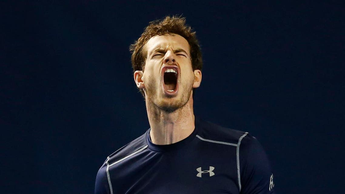 Great Britain's Andy Murray reacts during his match against Japan's Kei Nishikori. (Reuters)