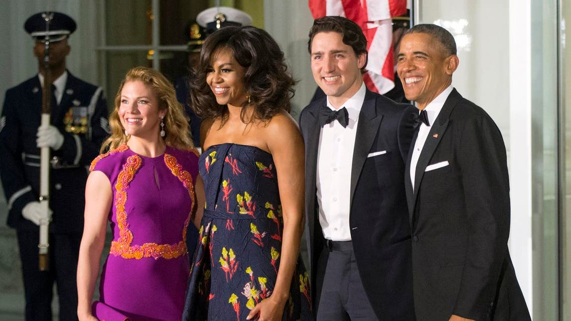 President Barack Obama and first lady Michelle Obama pose for a photo with Canadian Prime Minister Justin Trudeau and Sophie Grégoire Trudeau at the North Portico of the White House in Washington, Thursday, March 10, 2016, as they arrive for a state dinner. (AP)