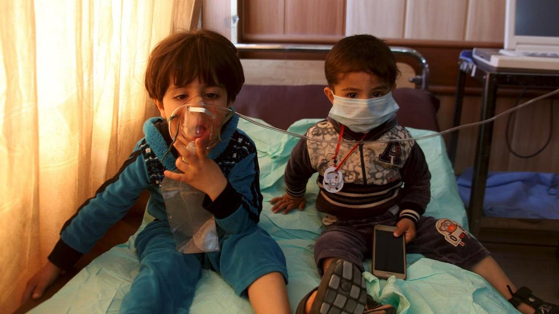 """Children receive oxygen, after suffering from choking, at a hospital in Taza south of Kirkuk, March 9, 2016. More than 40 people suffered partial choking and skin irritation in northern Iraq when Islamic State fired mortar shells and Katyusha rockets filled with """"poisonous substances"""" into their village late on Tuesday, local officials said. REUTERS/Stringer"""