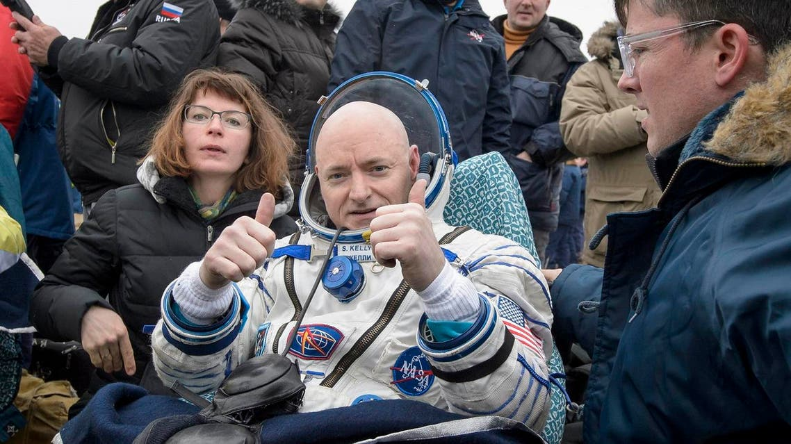 Expedition 46 Commander Scott Kelly of NASA rest in a chair outside of the Soyuz TMA-18M spacecraft just minutes after he and Russian cosmonauts Mikhail Kornienko and Sergey Volkov of Roscosmos landed in a remote area near the town of Zhezkazgan, Kazakhstan on March 2, 2016 (Kazakh time). Kelly and Kornienko completed an International Space Station record year-long mission to collect valuable data on the effect of long duration weightlessness on the human body that will be used to formulate a human mission to Mars. Volkov returned after spending six months on the station. REUTERS