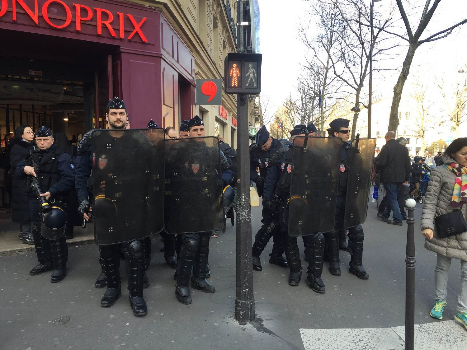 Paris police watch on as protesters take part in anti state of emergency demonstrations in Paris on Saturday March 12  (Photo: Asma Ajroudi)