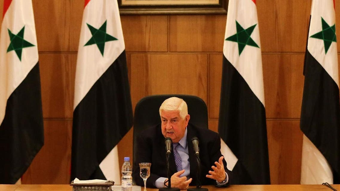 """Syrian Foreign Minister Walid al-Muallem speaks in front of a portrait of Syrian President Bashar al-Assad during a press conference on March 12, 2016 in the capital Damascus. Syrian President Bashar al-Assad's ouster remains a """"red line"""" for the government, Muallem said ahead of fragile peace talks in Geneva."""