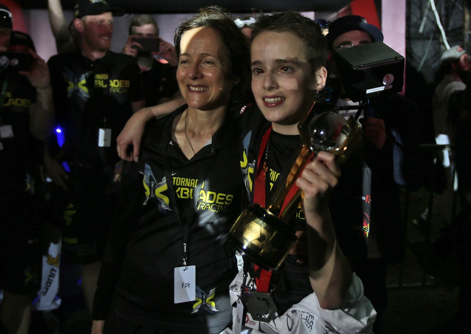 Luke Bannister of Somerset holds the trophy next to his mother (Photo: AP)