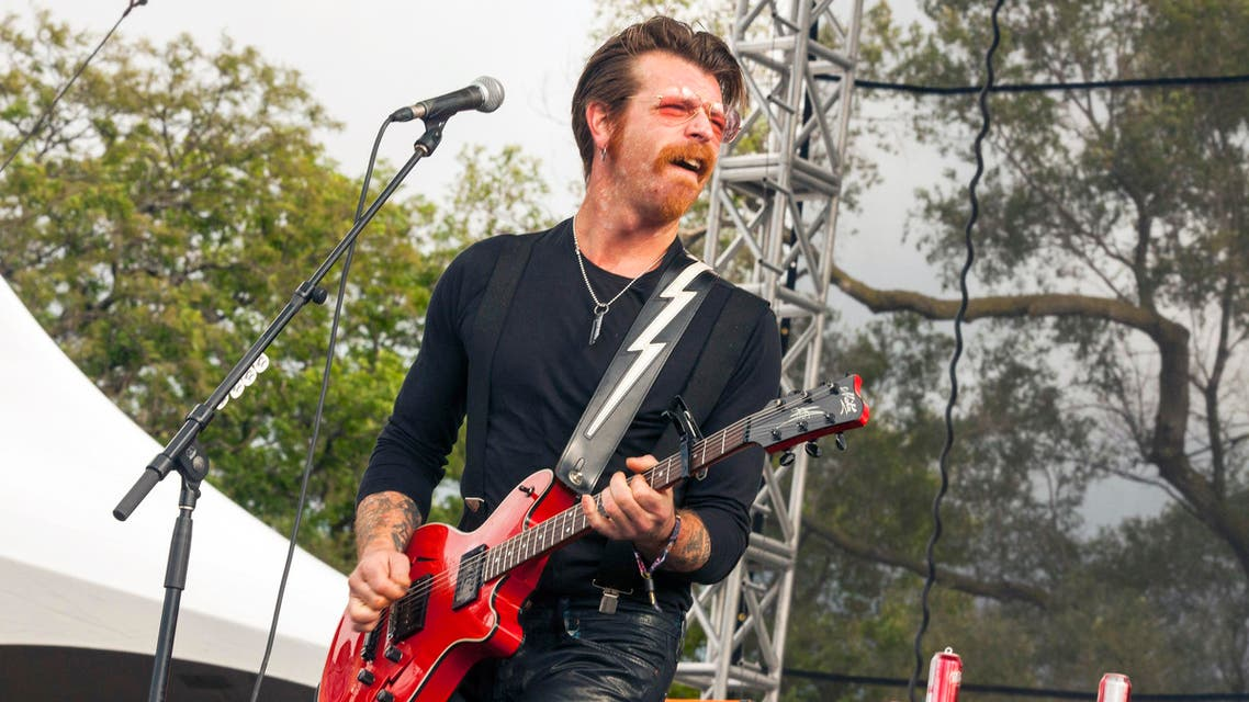 "FILE - In this Sept. 11, 2015 file photo, Jesse Hughes of Eagles of Death Metal performs at Riot Fest & Carnival in Douglas Park in Chicago. Hughes, frontman of the U.S. band whose Nov. 13 performance at the Bataclan theater in Paris was stormed by Islamic extremist suicide bombers, says he feels a ""sacred"" responsibility to finish the show and is happy to be back in Paris despite raw nerves. The Eagles of Death Metal band is scheduled to play at the Olympia Theatre in Paris on Tuesday, Feb. 16, 2016 - just a little over three months to the day since the Paris attacks that killed 89 people. (Photo by Barry Brecheisen/Invision/AP, File)"