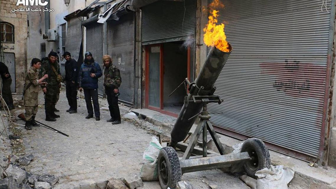 This file photo provided on Sunday Feb. 15, 2015 by the Syrian anti-government activist group Aleppo Media Center (AMC), which has been authenticated based on its contents and other AP reporting, shows Syrian rebels firing locally made shells against the Syrian government forces, in Aleppo, Syria. (AP Photo/Aleppo Media Center, AMC, File)