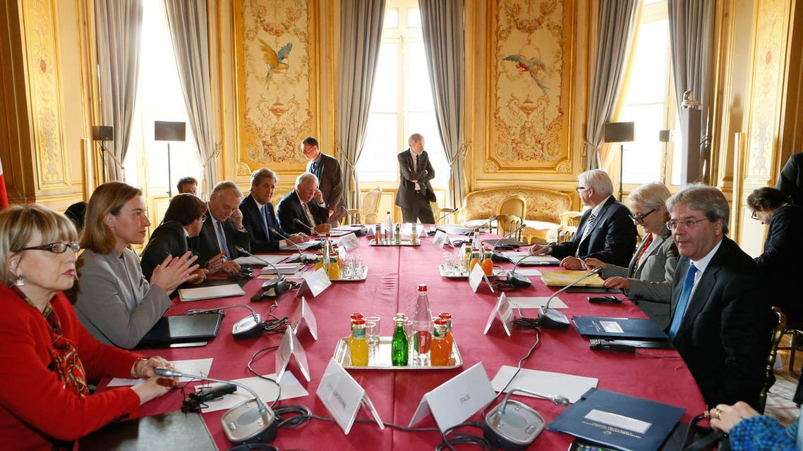European Union foreign policy chief Federica Mogherini, second left, French Foreign Minister Jean Marc Ayrault, fourth left, United States Secretary of State John Kerry, fifth left, Italian Foreign Minister Paolo Gentiloni, right, and German Foreign Minister Frank-Walter Steinmeier, third right, attend a meeting at the Quai d'Orsay ministry in Paris, Sunday, March 13, 2016