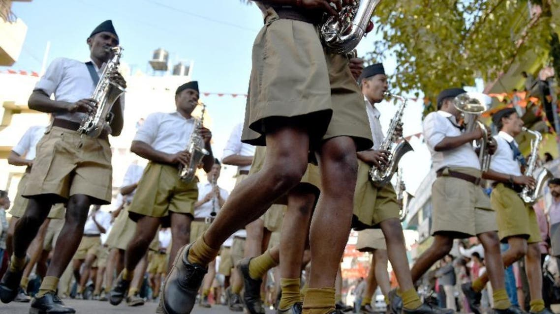 Foot soldiers of the Rashtriya Swayamsevak Sangh (RSS) are often seen after dawn across India engaged in physical drills and uttering religious chants -- dressed in pleated shorts, white shirts and black hats (AFP)