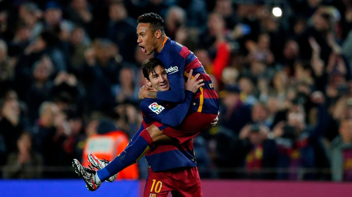 FC Barcelona's Lionel Messi, left, celebrates after scoring against Sevilla with his teammate Neymar during a Spanish La Liga soccer match at the Camp Nou stadium in Barcelona, Spain, Sunday, Feb. 28, 2016. (AP)