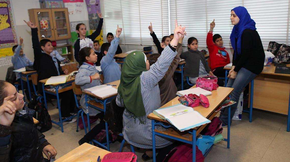 Teacher Myassar Itani (R) holds an English language class at Beirut's Mohammed Shamel Public School (Photo: Roudy Lattouf)