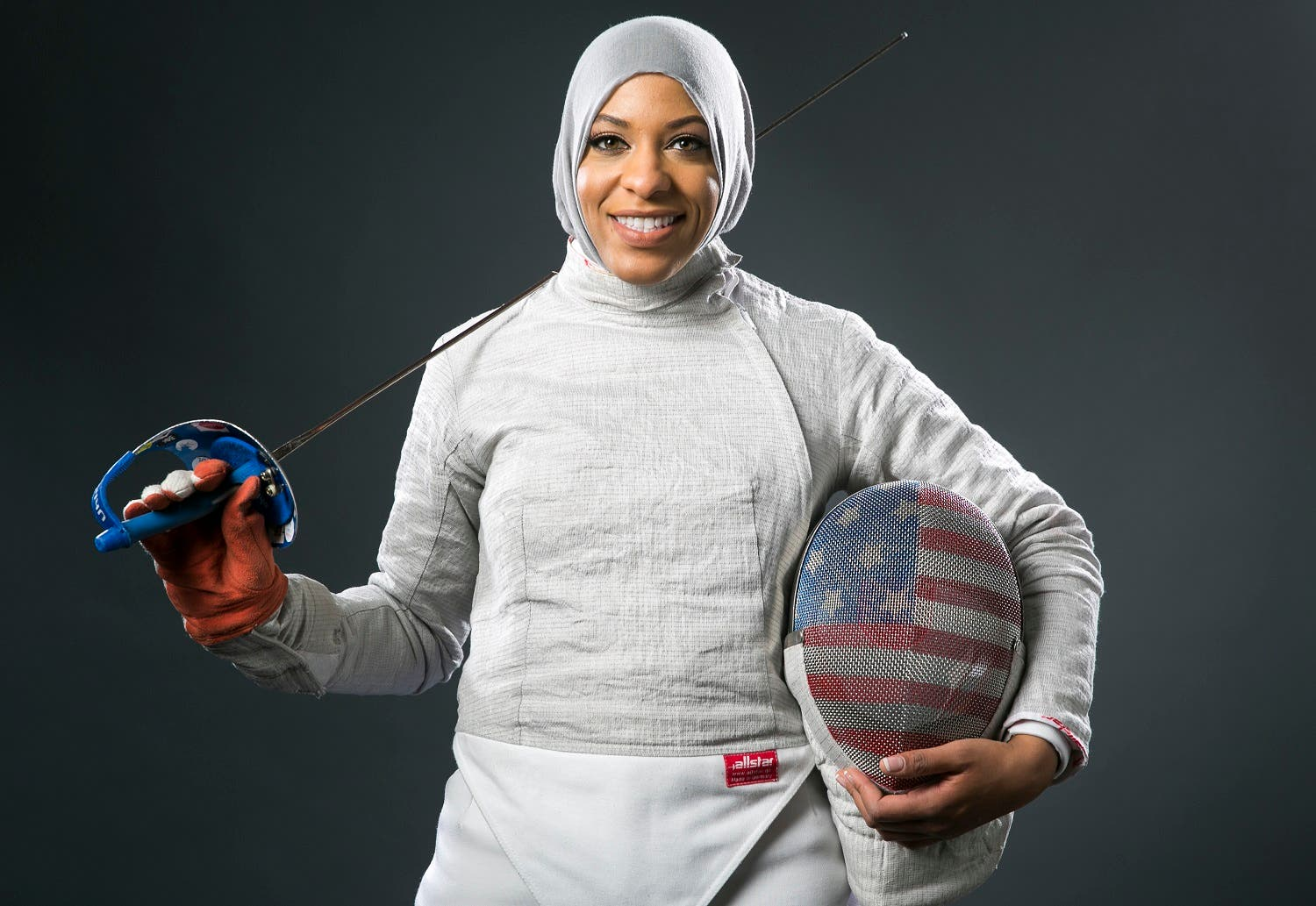 Fencer Ibtihaj Muhammad poses for photos at the 2016 Team USA Media Summit Wednesday, March 9, 2016, in Beverly Hills, Calif. (AP)