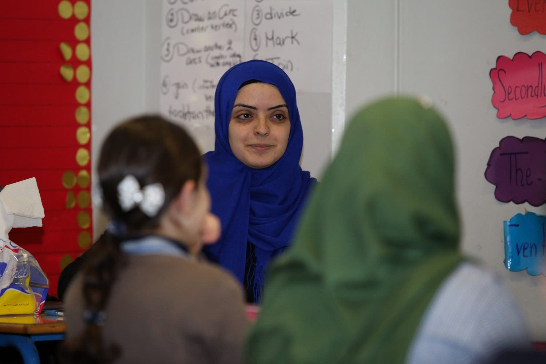 Teacher Myassar Itani (C) holds an English language class at Beirut's Mohammed Shamel Public School (Photo: Roudy Lattouf)