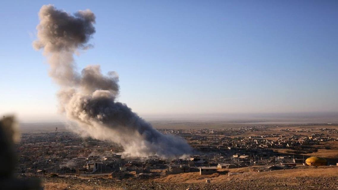 Nov. 12, 2015, file photo, smoke believed to be from an airstrike billows over the northern Iraqi town of Sinjar (AP)