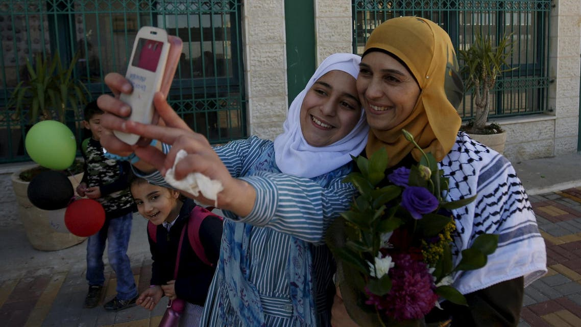 A Palestinian student takes a selfie with teacher Hanan Al Hroub, who is shortlisted to win the Global Teacher Prize, in the West Bank city of Ramallah February 17, 2016. Picture taken February 17. Reuters