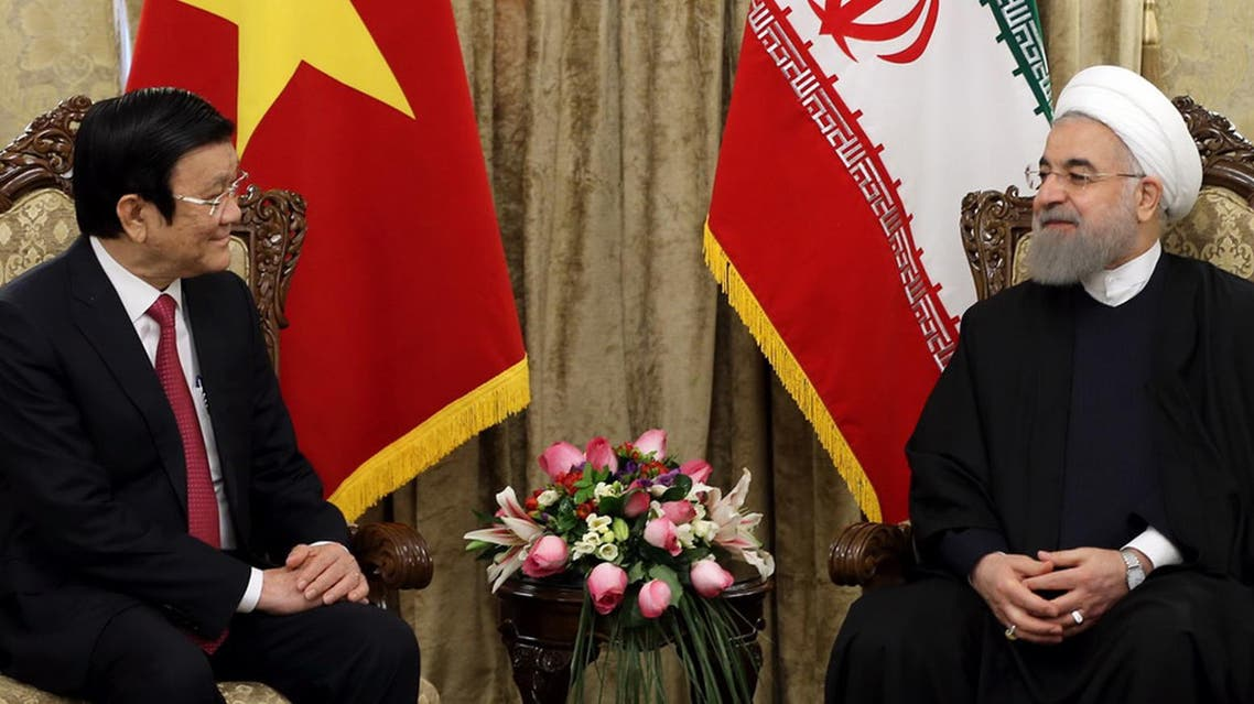 President Hassan Rowhani, right, meets with Vietnam's President Truong Tan Sang at the Saadabad Palace in Tehran, Iran, Monday, March 14, 2016.  (AP)